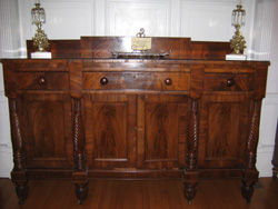 A mahogany wood and mahogany wood veneer side board circa 1850.