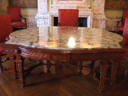 Hand carved Circassian walnut table with marble top
